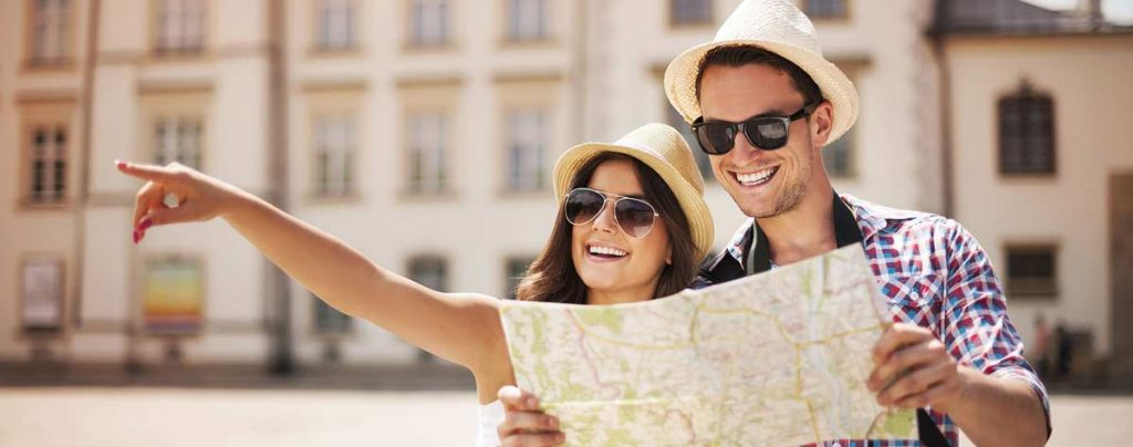 Male and Female tourists enjoying an overseas holiday after being vaccinated against serious illness and disease