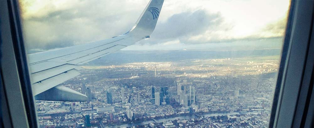 Aerial view of a city from inside a plane
