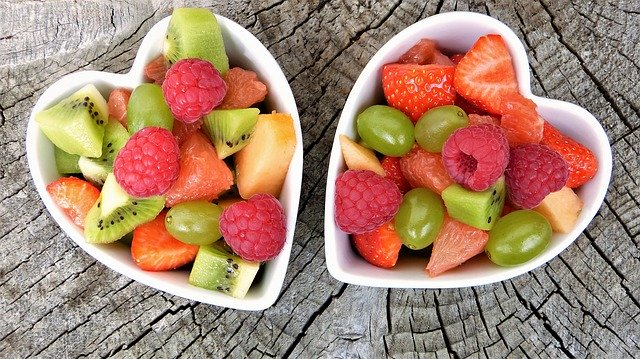 Two bowls of cut fruits with berries from five food groups for healthy diet, Cranbourne Doctors