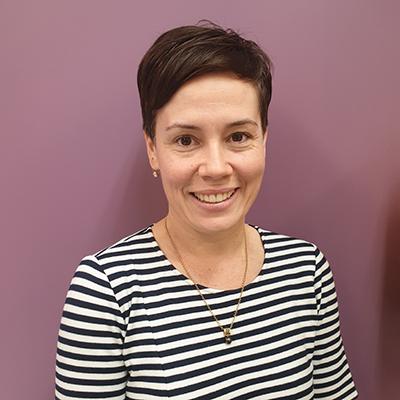 Portrait image of Dr Erin Harrison smiling