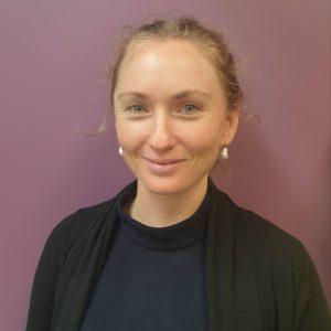 Portrait image of Ms Jarrah Curry smiling