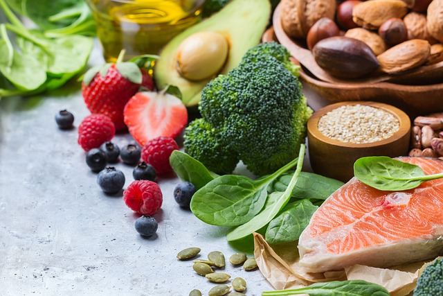 Selection of fruits, nuts, leafy vegetables and healthy protein