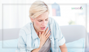 A woman suffering from an episode of shortness of breathe which can be either asthma or bronchiectasis